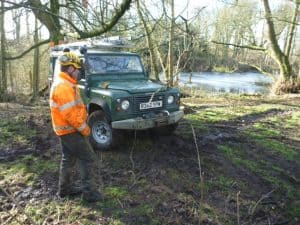 Winch equipped land rover at work